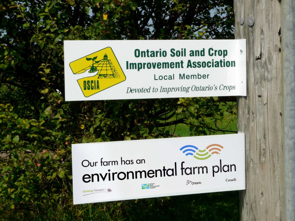 OSCIA local member and EFP gate signs