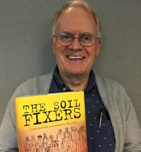 "Harold Rudy with his book ""The Soil Fixers"""