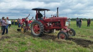 Plow demonstration in field