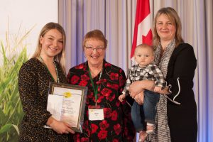Olivia Lumley accepting the award on behalf of her father (left) with Ruth Hill and Merilee Hill