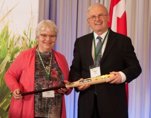 Anne Loeffler (left) accepting Soil Champion award from OSCIA President Stuart Wright